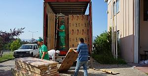 İnegöl'de sel mağduru 60 haneye mobilya yardımı